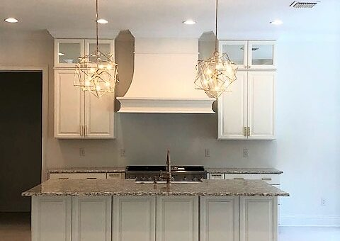 white kitchen center island gold lighting and accents