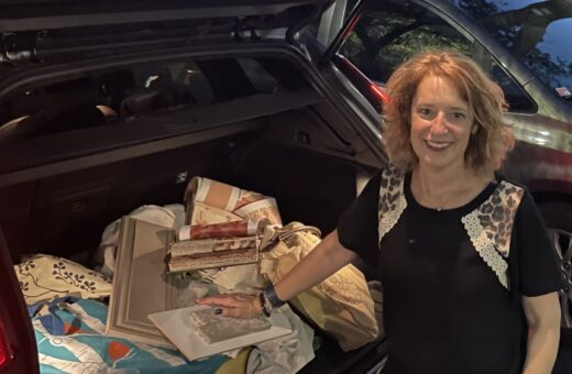 Johanna at her car with interior design samples and plans